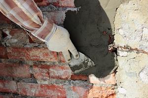 man performing masonry restoration services