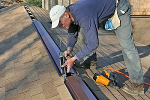 worker on an exterior caulking project