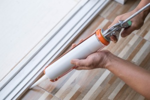 Silicone caulking with gun