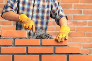 Man working on Masonry with bricks
