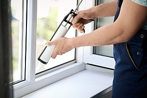 Artist caulk sealing window