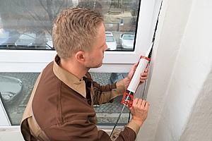 Professional caulking service sealing window frame