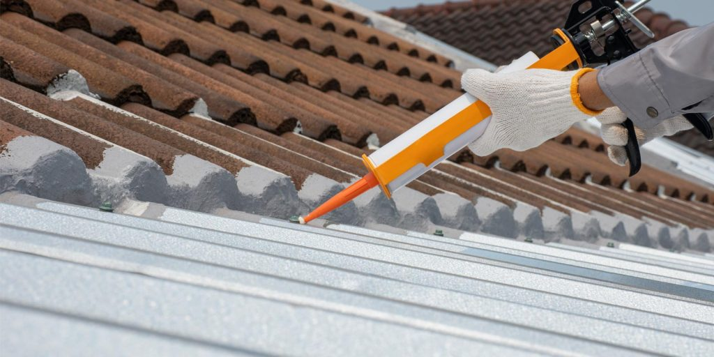 a commercial caulking contractor working on the roof of a building