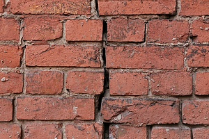 Crack going through a brick wall