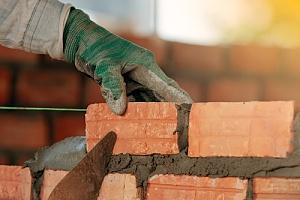 Repair man laying brick