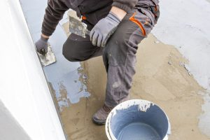 professional waterproofing concrete at a site
