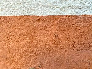 orange colored stucco wall that has been hardened