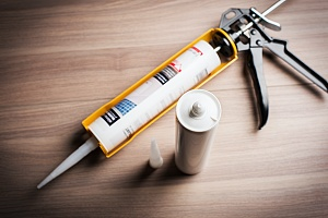 a tube of caulking that you can put different types of residential caulks in