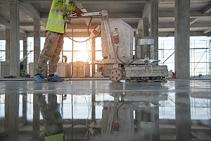 contractor applying penetrating sealer on a concrete surface