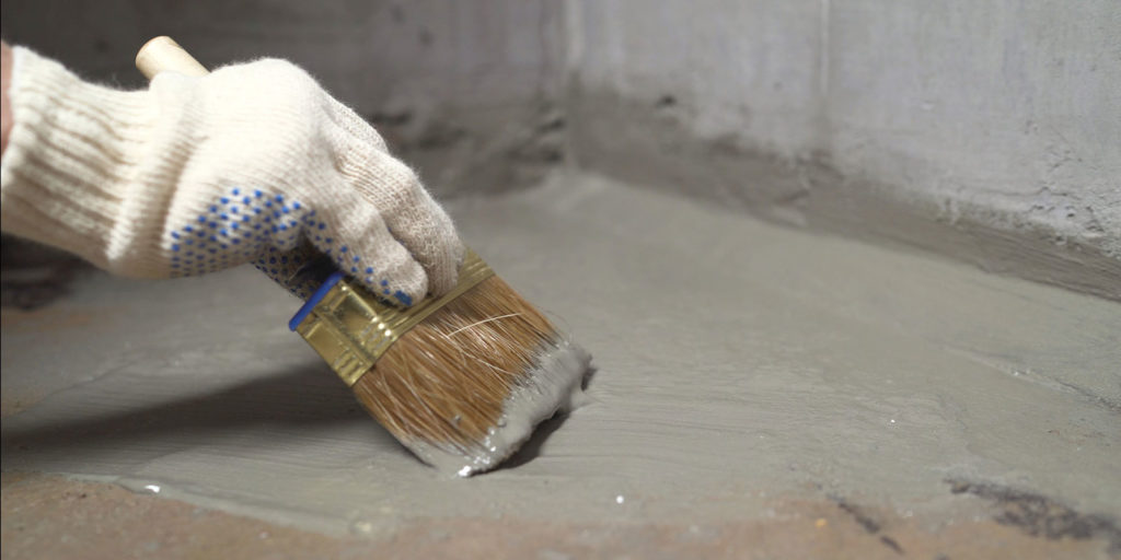 applying Cementitious Waterproofing to the floor