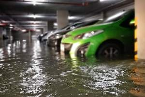 A flooded basement carpark. Waterproofing is a process that prevents moisture from entering a basement