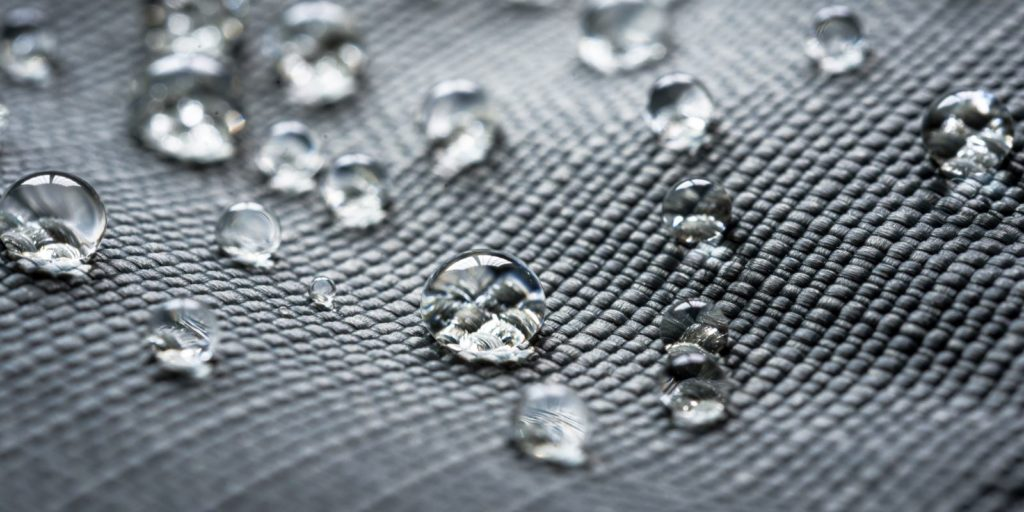 Waterproof coating with water droplets. Waterproofing your home can help protect from water damage
