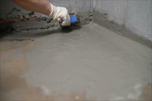waterproofing service working on a basement