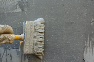 waterproofing service painting on a wall