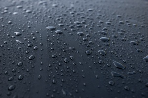 water drops on black background once used a waterproofing contractor