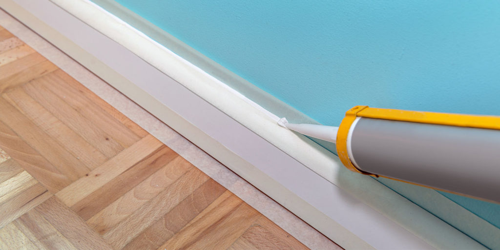 interior caulking being done in a home