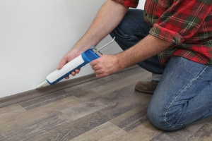 man hired to do Interior Caulking inside a house