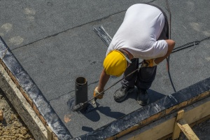 waterproofing contractor working on a roof