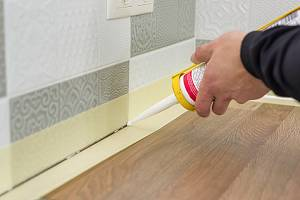 Caulk being applied on wall joints. Paper Sealing works must be done by a professional