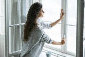 Women Opening with new window glazing While Having Coffee