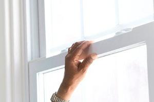 Man Holding Window