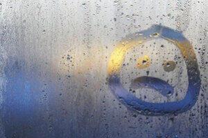 Window Condensation with Sad Smiley needing window glazing