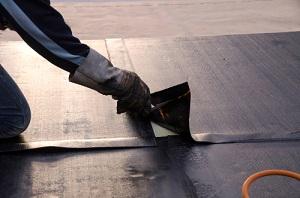 Worker Applying Waterproof Material for a Waterproofing Company