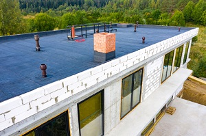 Workers Applying Waterproof Material on New Building from a Waterproofing Company