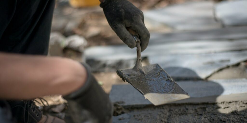 a male hand in work gloves while masonry repair