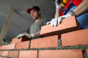 builders make wall brick and cement during Masonry Repair Service