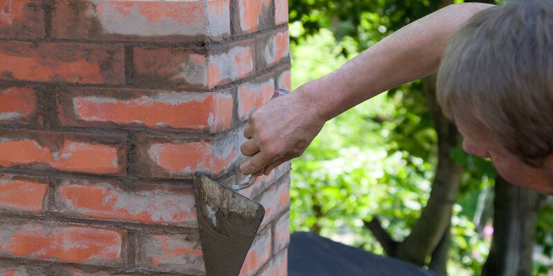 man making masonry works