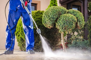 pressure washer cleaning residential driveway