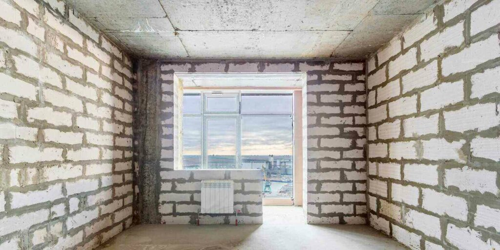 unfinished room in a residential building under construction with the window