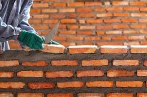 Masonry Repair worker clay masonry brick wall