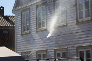 high pressure cleaning of wall house from pressure washing services