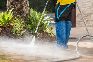 man cleaning floor for Commercial Pressure Washing