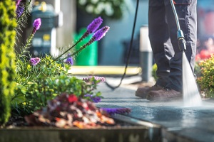 men cleaning garden cobble stone path with Commercial Pressure Washing Services